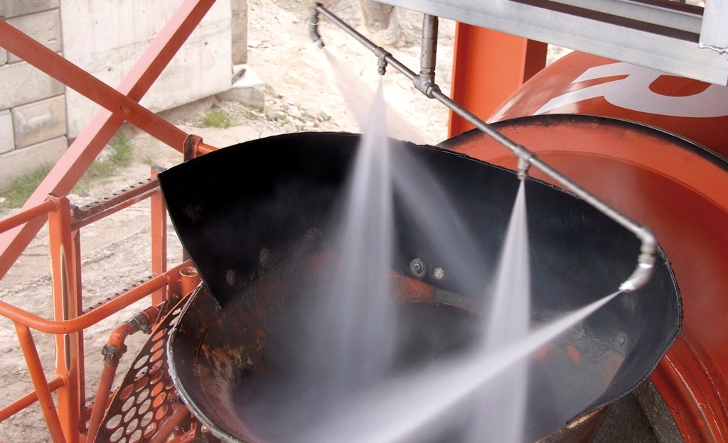 Concrete truck chute cleaning system